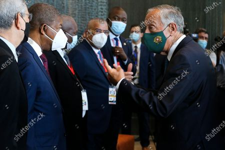Portuguese President Marcelo Rebelo de Sousa (R) talks with Angola President Joao Lourenco (2-L) prior to the 13th Conference of Heads of State and Government of the Community of Portuguese-speaking Countries (CPLP), in Luanda, Angola, 17 July 2021.