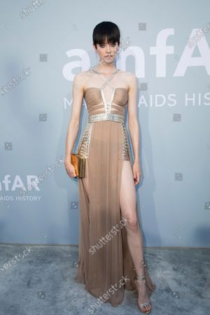 Maike Inga poses for photographers upon arrival at the amfAR Cinema Against AIDS benefit the during the 74th Cannes international film festival, Cap d'Antibes, southern France