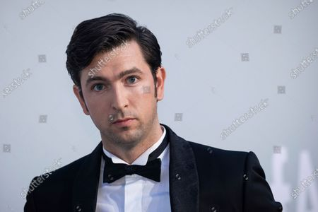 Nicholas Braun poses for photographers upon arrival at the amfAR Cinema Against AIDS benefit the during the 74th Cannes international film festival, Cap d'Antibes, southern France