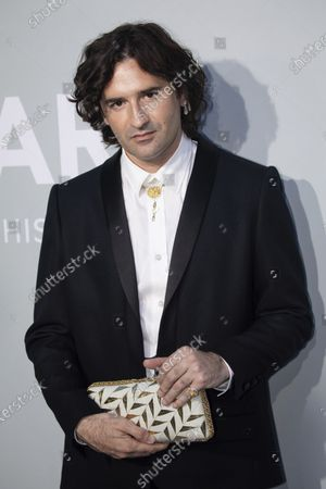 Nicolas Maury poses for photographers upon arrival at the amfAR Cinema Against AIDS benefit the during the 74th Cannes international film festival, Cap d'Antibes, southern France