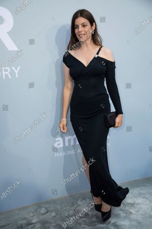 Julia Restoin Roitfeld poses for photographers upon arrival at the amfAR Cinema Against AIDS benefit the during the 74th Cannes international film festival, Cap d'Antibes, southern France
