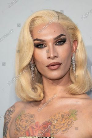 Stock Photo of Miss Fame poses for photographers upon arrival at the amfAR Cinema Against AIDS benefit the during the 74th Cannes international film festival, Cap d'Antibes, southern France
