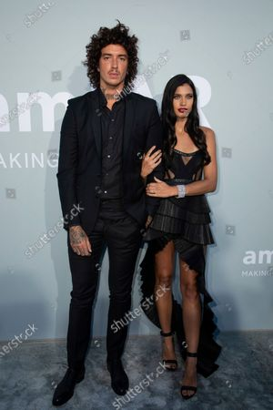 Stock Photo of Julian Perretta and Kambree Dalton pose for photographers upon arrival at the amfAR Cinema Against AIDS benefit the during the 74th Cannes international film festival, Cap d'Antibes, southern France