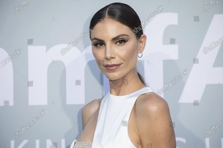 Nina Senicar poses for photographers upon arrival at the amfAR Cinema Against AIDS benefit the during the 74th Cannes international film festival, Cap d'Antibes, southern France