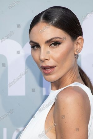 Stock Picture of Nina Senicar poses for photographers upon arrival at the amfAR Cinema Against AIDS benefit the during the 74th Cannes international film festival, Cap d'Antibes, southern France