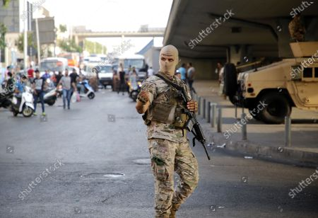 (210716) - BEIRUT, July 16, 2021 (Xinhua) - A member of the Lebanese army is seen near the spot where protesters block a road in Beirut, Lebanon, on July 16, 2021. Lebanese Protestors closed roads in Beirut for the second day on Friday, a day after the resignation of Prime Minister-designate Saad Hariri. Hariri announced on Thursday his failure to form a cabinet, citing irreconcilable disagreements with President Michel Aoun. The announcement has prompted a dozen of protests across the country.