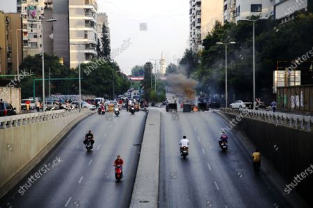 (210716) - BEIRUT, July 16, 2021 (Xinhua) - A road is blocked by protesters in Beirut, Lebanon, on July 16, 2021. Lebanese Protestors closed roads in Beirut for the second day on Friday, a day after the resignation of Prime Minister-designate Saad Hariri. Hariri announced on Thursday his failure to form a cabinet, citing irreconcilable disagreements with President Michel Aoun. The announcement has prompted a dozen of protests across the country.