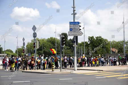 Opponents of Cameroon's President Paul Biya protest against his presence in Geneva, at place des Nations in front of the European headquarters of the United Nation in Geneva, Switzerland, 17 July 2021.