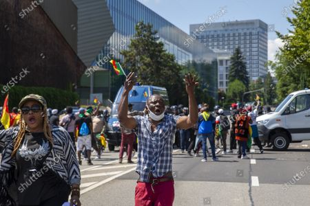 Opponents of Cameroon's President Paul Biya protest against his presence in Geneva, during a demonstration at place des Nations in front of the European headquarters of the United Nation in Geneva, Switzerland, 17 July 2021.