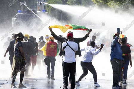 Swiss riot police use water cannon against opponents of Cameroon's President Paul Biya who protest against his presence in Geneva, during a demonstration at place des Nations in front of the European headquarters of the United Nation in Geneva, Switzerland, 17 July 2021.