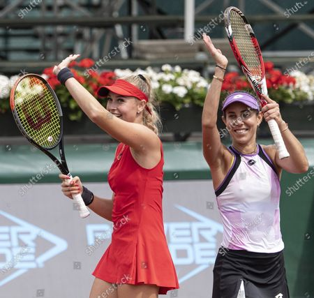 Fanny Stollar of Hungary (L) and Mihaela Buzarnescu of Romania celebrate during the award ceremony after they won the Hungarian Ladies Open double final match against Aliona Bolsova of Spain and Tamara Korpatsch of Germany in Budapest, Hungary 17 July 2021.