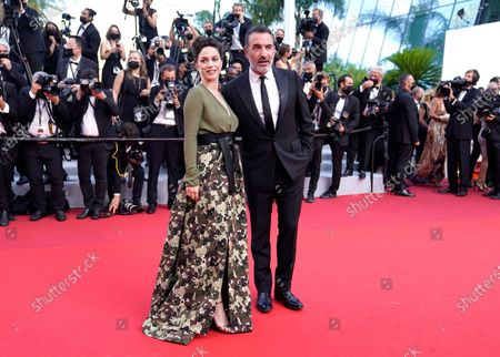 Nathalie Pechalat, left, and Jean Dujardin pose for photographers upon arrival at the awards ceremony and premiere of the closing film 'OSS 117: From Africa with Love' at the 74th international film festival, Cannes, southern France