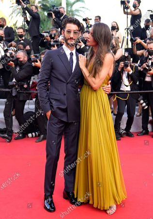 Pierre Niney, left, and Natasha Andrews pose for photographers upon arrival at the awards ceremony and premiere of the closing film 'OSS 117: From Africa with Love' at the 74th international film festival, Cannes, southern France