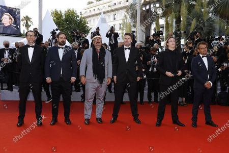 Stock Photo of Shaun Grant (L), Justin Kurzel (2-L), Nick Batzias (3-L), Caleb Landry Jones (2-R), and guests arrive for the Closing Awards Ceremony of the 74th annual Cannes Film Festival, in Cannes, France, 17 July 2021. The Golden Palm winning movie will be screened after the closing ceremony.