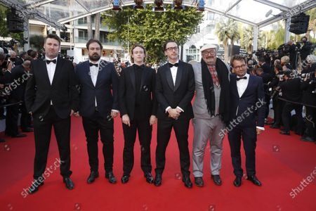 Justin Kurzel (2-L), Caleb Landry Jones (3-L), Shaun Grant (3-R), Nick Batzias (2-R), and guests arrive for the Closing Awards Ceremony of the 74th annual Cannes Film Festival, in Cannes, France, 17 July 2021. The Golden Palm winning movie will be screened after the closing ceremony.