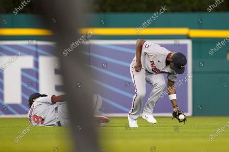 Minnesota Twins shortstop Andrelton Simmons (9) falls and center fielder Nick Gordon reaches for the single by designated hitter Miguel Cabrera during the eighth inning of the second baseball game of a doubleheader, in Detroit