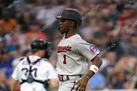Minnesota Twins' Nick Gordon (1) scores from third on a wild pitch during the eighth inning of the second baseball game of a doubleheader against the Detroit Tigers, in Detroit