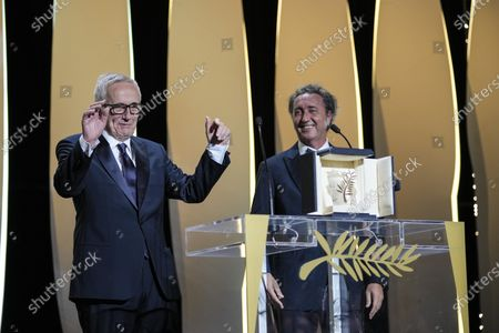 Stock Image of Paolo Sorrentino, right, and Marco Bellocchio, winner of the honorary Palme d'Or appear during the awards ceremony at the 74th international film festival, Cannes, southern France