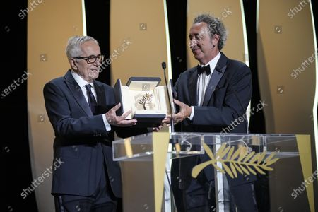 Stock Picture of Paolo Sorrentino, right, and Marco Bellocchio, winner of the honorary Palme d'Or appear during the awards ceremony at the 74th international film festival, Cannes, southern France