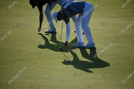 Jordan Spieth of the U.S. (L) and Dylan Frittelli of South Africa (R) on the green during the 3rd round of The Open 2021 golf championship at Royal St George's golf course in Sandwich, Kent, Britain, 17 July 2021.