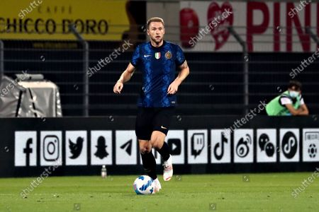 Stock Image of Milan Skriniar of FC Internazionale in action during the Pre-Season Friendly match between Lugano and FC Internazionale at Cornaredo Stadium on July 17, 2021 in Lugano, Switzerland.