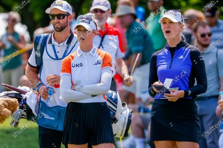 Stock Picture of Sisters Nelly Korda (L) of the US and Jessica Korda (R) of the US react on the third hole during the final round of the Dow Great Lakes Bay Invitational women's golf tournament at the Midland Country Club in Midland, Michigan, USA, 17 July 2021.