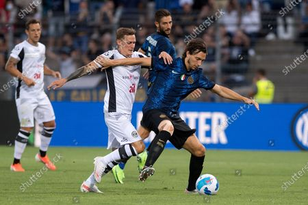 Stock Image of Lugano's player Mattia Bottani (L) fights for the ball with Inter's player Matteo Darmian during the pre-season friendly soccer match between FC Lugano and FC Inter Milan, at Cornaredo Stadium in Lugano, Switzerland, 17 July 2021.