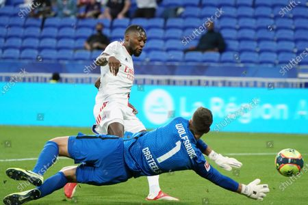 Lyon's Moussa Dembele scores a goal during the friendly soccer match between Lyon and Wolfsburg in Decines, near Lyon, central France