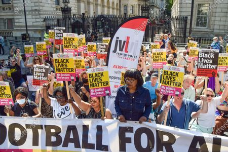 Labour MP, Diane Abbott stands with demonstrators taking the knee and holding Black Lives Matter placards during the anti-racism protest. Demonstrators held speeches and took the knee outside Downing Street in solidarity with England football players; Marcus Rashford, Bukayo Saka and Jadon Sancho, following the online racist abuse the trio received after the Euro 2020 final between England and Italy.