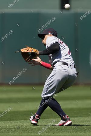 Cleveland Indians second baseman Cesar Hernandez cannot make the catch on a hit by Oakland Athletics' Matt Chapman during the sixth inning of a baseball game, in Oakland, Calif. Chapman was safe at first base