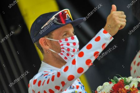Michael Woods (CAN) celebrates on the podium as the secured the best climber classification polka-dot jersey after the fourteenth stage of Tour de France cycling race over 183.7 kilometers (114.1 miles) with start in Carcassonne and finish in Quillan, France, Saturday, July 10, 2021.