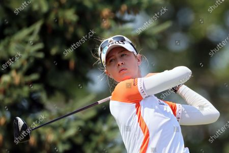 Stock Image of Nelly Korda of the United States hits from the 14th tee during the final round of the Dow Great Lakes Bay Invitational at Midland Country Club in Midland, Michigan, on Saturday, July 17, 2021.