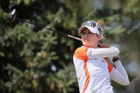 Stock Photo of Nelly Korda of the United States hits from the 14th tee during the final round of the Dow Great Lakes Bay Invitational at Midland Country Club in Midland, Michigan, on Saturday, July 17, 2021.