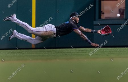 Miami Marlins center fielder Monte Harrison (3) catches a fly ball from Philadelphia Phillies' Luke Williams during the ninth inning of a baseball game, in Philadelphia