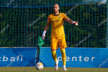 Stock Picture of Marko Dmitrovic of Sevilla controls the ball during the pre-season friendly match between Sevilla CF and Coventry City at Pinatar Arena on July 17, 2021 in Murcia, Spain.