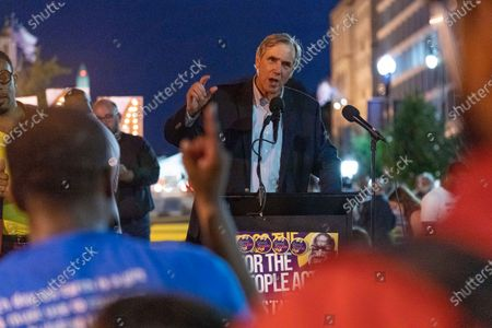 Sen. Jeff Merkley, D-Ore., speaks during the Good Trouble Candlelight Vigil for Democracy, supporting voting rights, at Black Lives Matter plaza in Washington