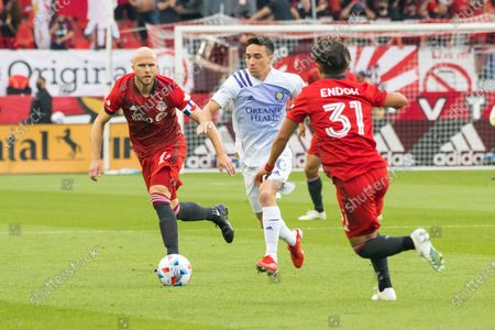 Michael Bradley (4), Tsubasa Endoh (31) and Mauricio Pereyra (10) in action during the MLS game between between Toronto FC and Orlando City SC at BMO Field. (Final score; Toronto FC 1-1 Orlando City SC).