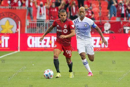 Auro da Cruz Jr (96) and Lu¸?s Carlos Almeida da Cunha also known as Nani (17) in action during the MLS game between between Toronto FC and Orlando City SC at BMO Field. (Final score; Toronto FC 1-1 Orlando City SC).