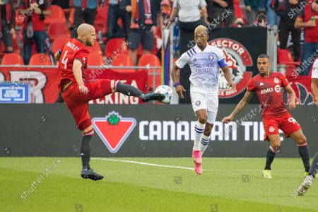 Michael Bradley (4), and Lui?s Carlos Almeida da Cunha also known as Nani (17) in action during the MLS game between between Toronto FC and Orlando City SC at BMO Field. (Final score; Toronto FC 1-1 Orlando City SC).