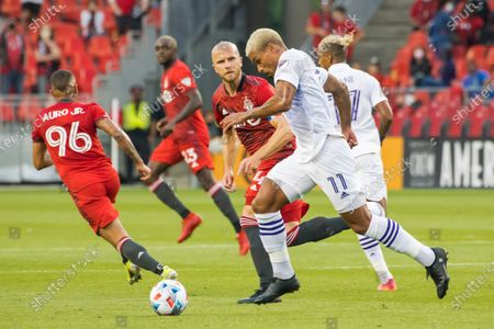 Stock Photo of Michael Bradley (4) and Junior de Almeida also known as Junior Urso (11) in action during the MLS game between between Toronto FC and Orlando City SC at BMO Field.  (Final score; Toronto FC 1-1 Orlando City SC).