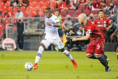 Michael Bradley (4) and Andres Perea (21) in action during the MLS game between between Toronto FC and Orlando City SC at BMO Field. (Final score; Toronto FC 1-1 Orlando City SC).