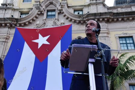 Jon Secada speaks on stage during the Rally for democracy in Cuba. Cuban American singer, songwriter, actor and Miami Dade College alumni Canela leads the effort with international artists and activists in supporting the freedom of the Cuban people in Cuba. July 17, 2021 in Miami