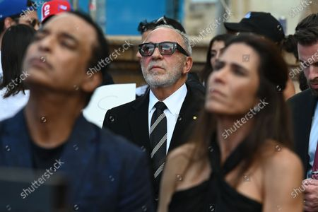 Emilio Estefan, Jon Secada and his wife Maritere Vilar are as Cuban Americans show support for protestors in Cuba during the Rally For Democracy at the Freedom Tower