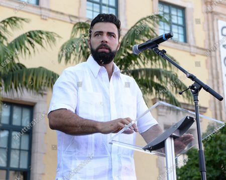 Jencarlos Canela speaks as Cuban Americans are showing support for protestors in Cuba during the Rally For Democracy at the Freedom Tower