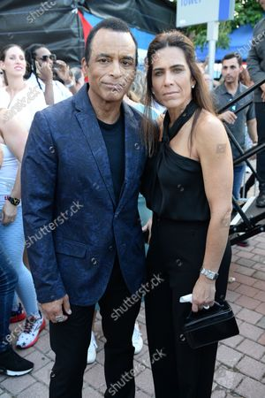 Jon Secada and his wife Maritere Vilar are as Cuban Americans show support for protestors in Cuba during the Rally For Democracy at the Freedom Tower