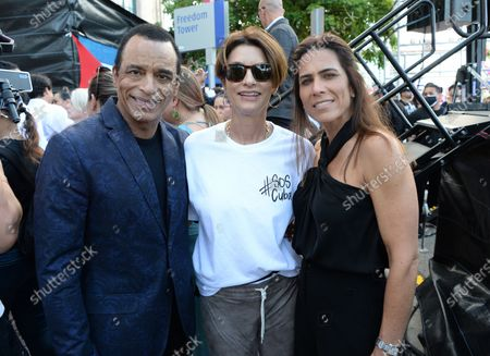 Jon Secada, Maritere Vilar and Ingrid Casares are as Cuban Americans show support for protestors in Cuba during the Rally For Democracy at the Freedom Tower
