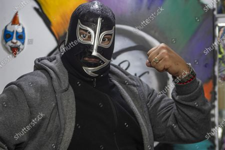 Stock Photo of Wrestling legend 'El Rayo de Jalisco' poses for photos during an autograph signing to fans  as part of his promotion event at Psy'kaza Decoration on July 17, 2021 in Mexico City, Mexico.