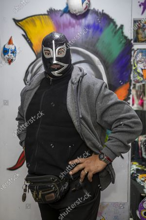 Wrestling legend 'El Rayo de Jalisco' poses for photos during an autograph signing to fans  as part of his promotion event at Psy'kaza Decoration on July 17, 2021 in Mexico City, Mexico.