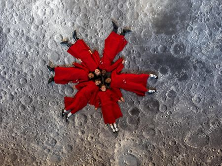 It's a Walk on the Moon at Peterborough Cathedral. A virtual moonscape by the artist Peter Walker using NASA images creates a copy of the moon underfoot.. Pictured Choristers from Peterborough Cathedral Choir.Peterborough Cathedral, Peterborough.