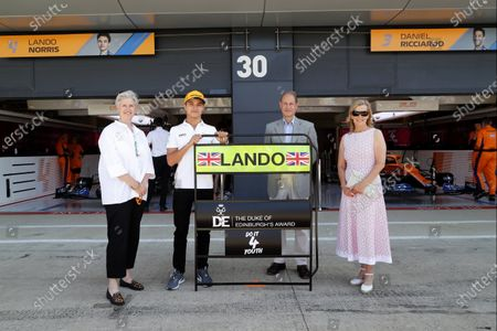 Prince Edward, Earl of Wessex and Sophie, Countess of Wessex with Lando Norris, McLaren (L) for the Duke of Edinburgh's Award  during the 2021 Formula One British Grand Prix